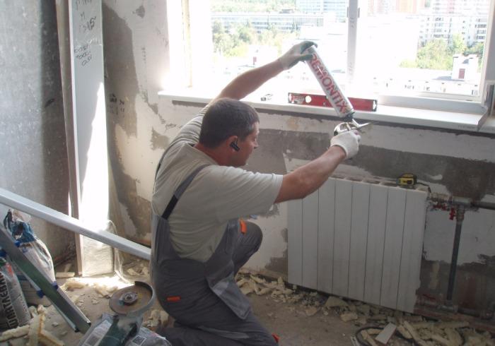 Установка окон в самом начале ремонта комнаты