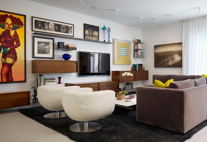 Размещение телевизора на главной стене в гостиной комнате